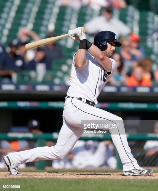 Andrew Romine of the Detroit Tigers singles to drive in two runs against the Oakland Athletics during the ninth inning at Comerica Park on September...