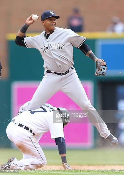 Andrew Romine of the Detroit Tigers slides into second base safe as Starlin Castro of the New York Yankees attempts to make the play during the eight...