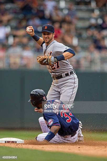 Andrew Romine of the Detroit Tigers throws against the Minnesota Twins on August 23 2014 at Target Field in Minneapolis Minnesota The Twins defeated...