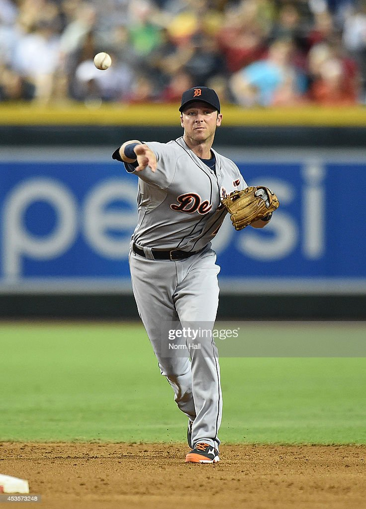 <a gi-track='captionPersonalityLinkClicked' href=/galleries/search?phrase=Andrew+Romine&family=editorial&specificpeople=2338123 ng-click='$event.stopPropagation()'>Andrew Romine</a> #27 of the Detroit Tigers throws the ball to first base against the Arizona Diamondbacks at Chase Field on July 23, 2014 in Phoenix, Arizona.