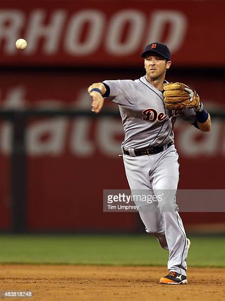 Andrew Romine of the Detroit Tigers throws to first base in the fifth inning of a game against the Kansas City Royals at Kauffman Stadium on August...