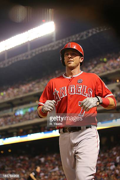 Andrew Romine of the Los Angeles Angels of Anaheim returns to the in the dugout after striking out against the Texas Rangers at Rangers Ballpark on...