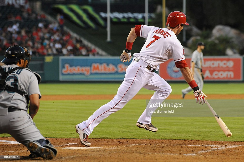 <a gi-track='captionPersonalityLinkClicked' href=/galleries/search?phrase=Andrew+Romine&family=editorial&specificpeople=2338123 ng-click='$event.stopPropagation()'>Andrew Romine</a> #7 of the Los Angeles Angels of Anaheim runs to first base after hitting a RBI single in the second inning against the Seattle Mariners at Angel Stadium of Anaheim on September 21, 2013 in Anaheim, California.