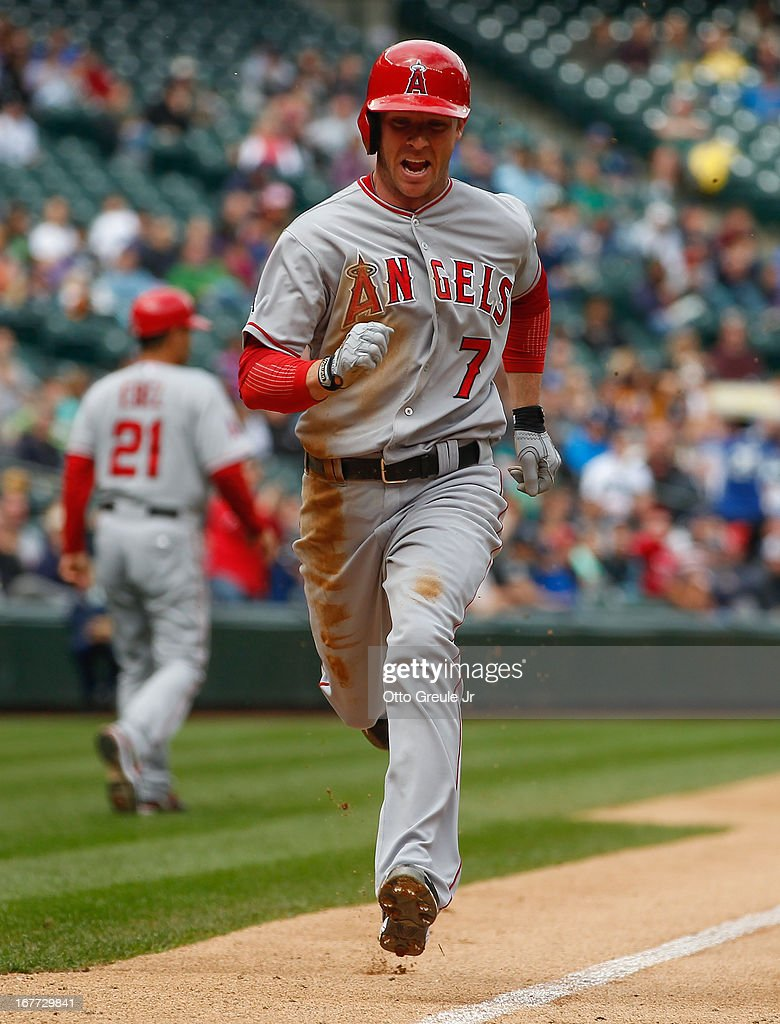 <a gi-track='captionPersonalityLinkClicked' href=/galleries/search?phrase=Andrew+Romine&family=editorial&specificpeople=2338123 ng-click='$event.stopPropagation()'>Andrew Romine</a> #7 of the Los Angeles Angels of Anaheim scores in the sixth inning against the Seattle Mariners at Safeco Field on April 28, 2013 in Seattle, Washington. The Mariners defeated the Angels 2-1.