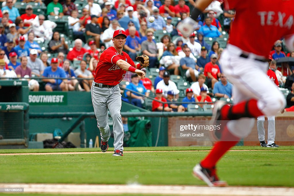 <a gi-track='captionPersonalityLinkClicked' href=/galleries/search?phrase=Andrew+Romine&family=editorial&specificpeople=2338123 ng-click='$event.stopPropagation()'>Andrew Romine</a> #7 of the Los Angeles Angels of Anaheim throws to first during a baseball game against the Texas Rangers at Rangers Ballpark in Arlington on September 28, 2013 in Arlington, Texas.