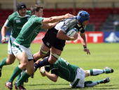 Andrew Rose of Scotland is tackled during the IRB Junior World Championships game between Ireland and Scotland on June 22 2008 at Rodney Parade...