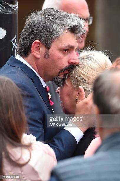 Andrew Roussos kisses Lisa Roussos after the funeral service of their daughter Manchester Arena Bombing victim SaffieRose Roussos at Manchester...