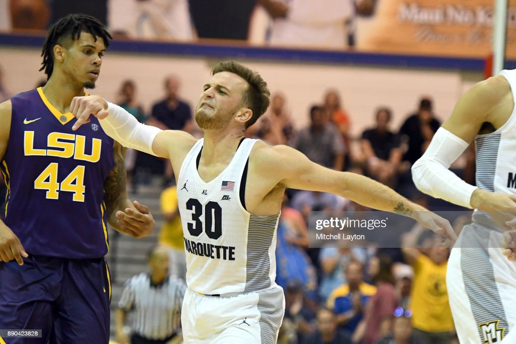 Andrew Rowsey #30 of the Marquette Golden Eagles celebrates a basket during a consultation college basketball game at the Maui Invitational against the LSU Tigers at the Lahaina Civic Center on November 22, 2017 in Lahaina, Hawaii. The Golden Eagles won 94-84.