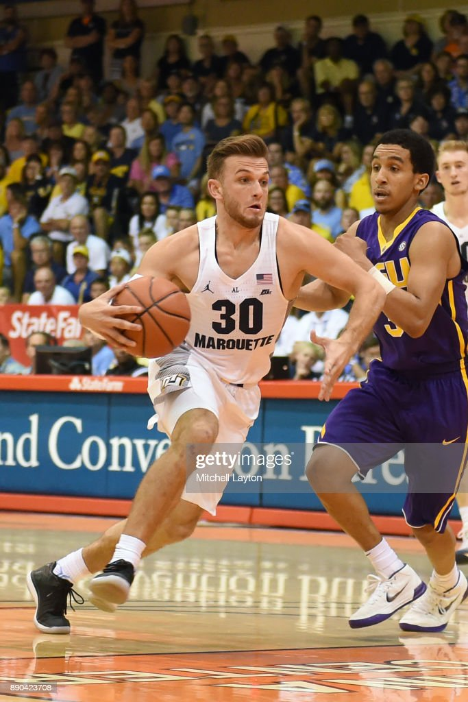 Andrew Rowsey #30 of the Marquette Golden Eagles dribbles the past Tremont Waters #3 of the LSU Tigers during a consultation college basketball game at the Maui Invitational at the Lahaina Civic Center on November 22, 2017 in Lahaina, Hawaii. The Golden Eagles won 94-84.