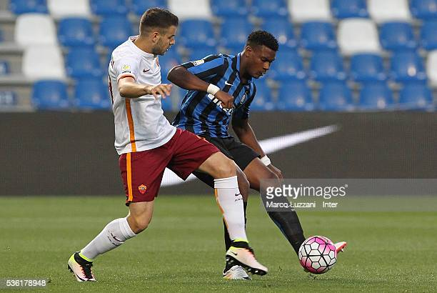 Andrew Ryan Gravillon of FC Internazionale is challenged by Marco Tumminello of AS Roma during the juvenile playoff match between FC Internazionale...