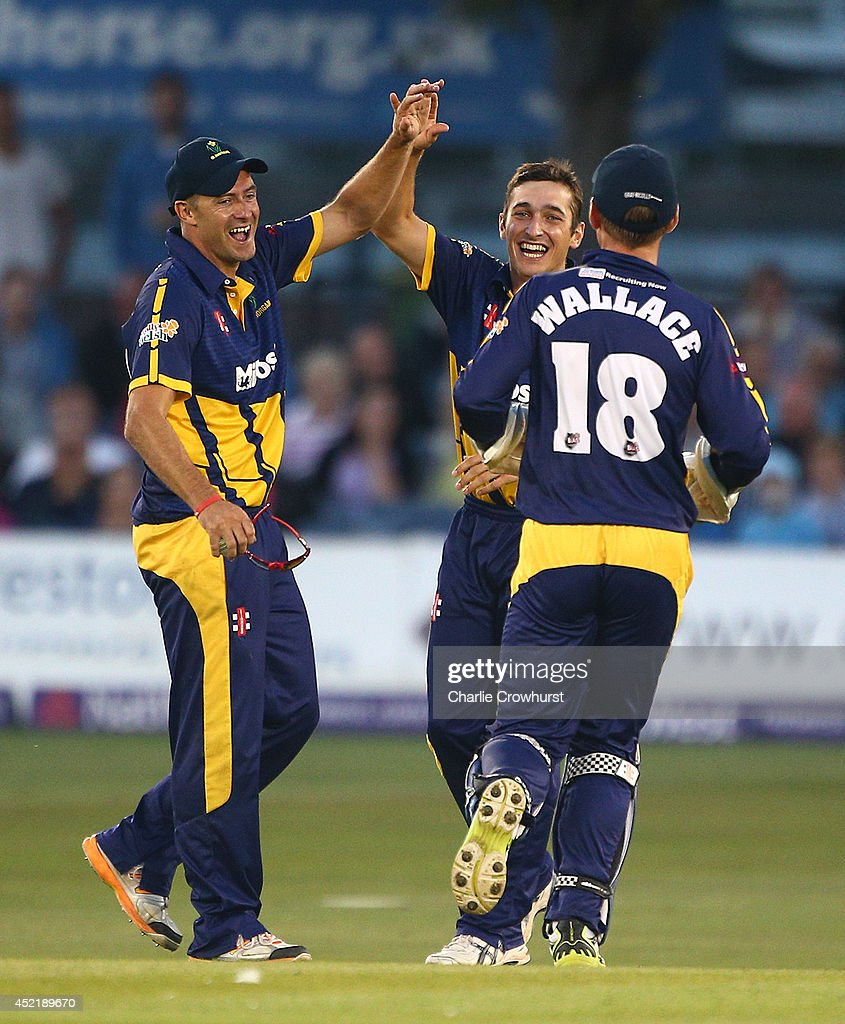 Andrew Salter of Glamorgan celebrates after taking the wicket of Luke Wright of Sussex with Dean Cosker and Mark Wallace during the Natwest T20 Blast match between Sussex Sharks and Glamorgan at The BrightonAndHoveJobs.com County Ground on July 15, 2014 in Hove, England.