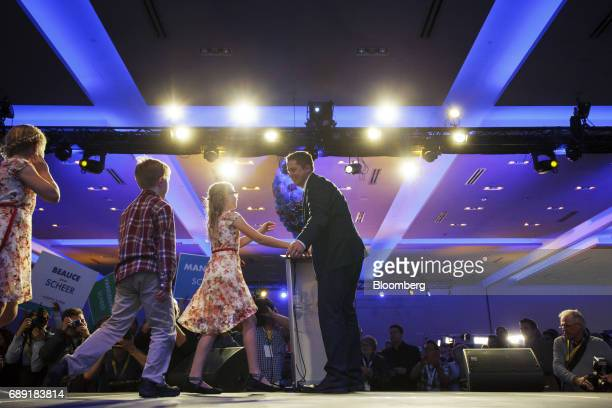 Andrew Scheer leader of Canada's Conservative Party right greets his family after being named the party's next leader during the Conservative Party...