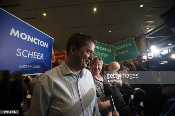 Andrew Scheer member of parliament and Conservative Party leader candidate smiles while speaking to members of the media outside of the Conservative...