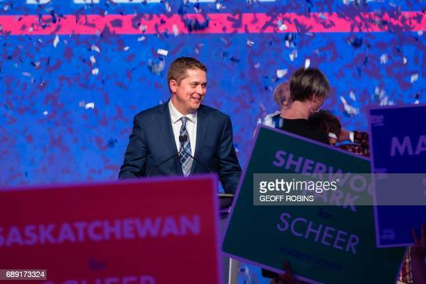 Andrew Scheer newly elected leader of the Conservative Party of Canada is showered in confetti during his acceptance speech at the party's convention...