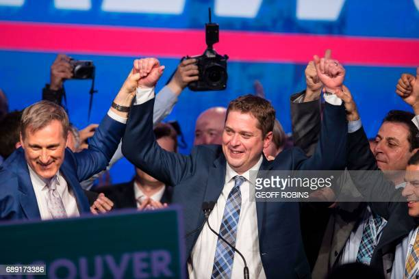 Andrew Scheer newly elected leader of the Conservative Party of Canada celebrates with his rival Maxime Bernier following his win at the party's...
