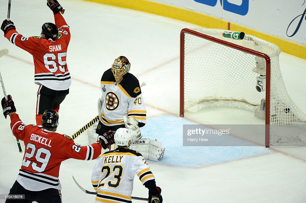 Andrew Shaw (R) #65 of the Chicago Blackhawks celebrates after he scored the game-winning goal in the third overtime against goalie Tuukka Rask #40 of the Boston Bruins to give the Blackhawks a 4-3 win in Game One of the NHL 2013 Stanley Cup Final at United Center on June 12, 2013 in Chicago, Illinois.