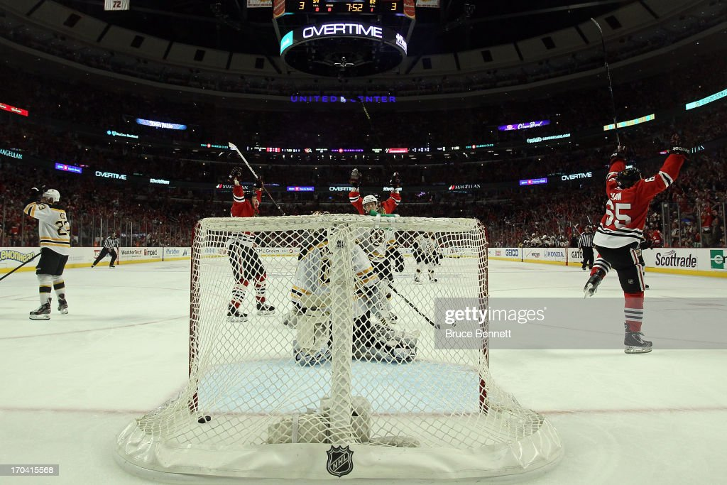 Andrew Shaw (R) #65 of the Chicago Blackhawks celebrates with teammates after they scored the game-winning goal in the third overtime to beat goalie Tuukka Rask #40 of the Boston Bruins in Game One of the 2013 NHL Stanley Cup Final at United Center on June 12, 2013 in Chicago, Illinois.