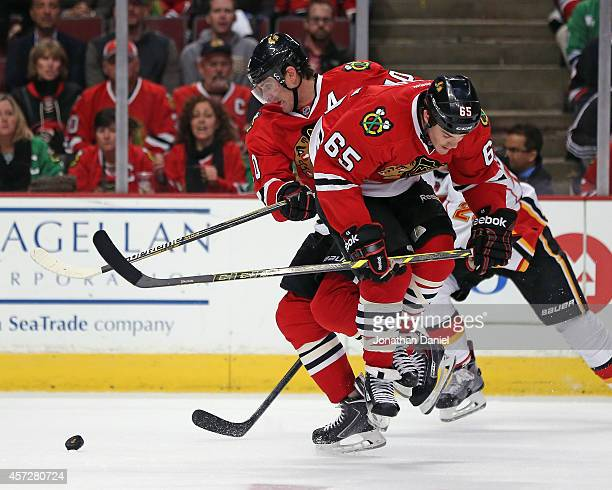 Andrew Shaw and Patrick Sharp of the Chicago Blackhawks collide during a game against the Calgary Flames at the United Center on October 15 2014 in...