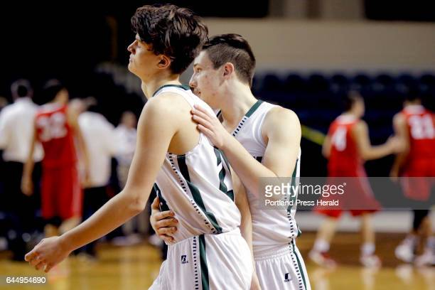 Andrew Shaw of Spruce Mountain is comforted by teammate Mason Shrink after the Phoenix last in the final seconds to Wells in a Class B South boys...