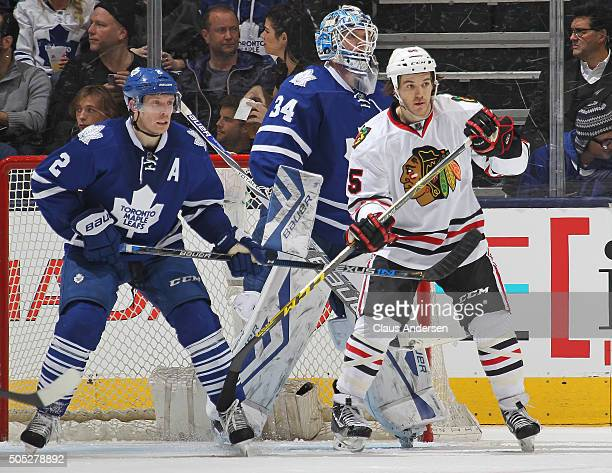 Andrew Shaw of the Chicago Black Hawks is held in check by Matt Hunwick of the Toronto Maple Leafs during an NHL game at the Air Canada Centre on...