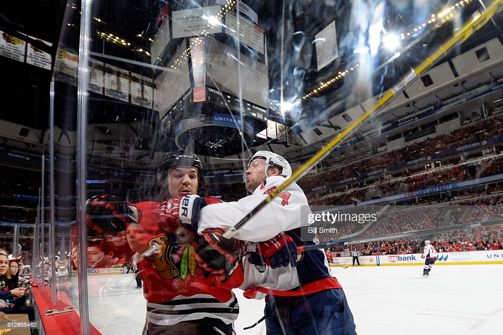 <a gi-track='captionPersonalityLinkClicked' href=/galleries/search?phrase=Andrew+Shaw+-+Ice+Hockey+Player&family=editorial&specificpeople=10568695 ng-click='$event.stopPropagation()'>Andrew Shaw</a> #65 of the Chicago Blackhawks and <a gi-track='captionPersonalityLinkClicked' href=/galleries/search?phrase=Brooks+Orpik&family=editorial&specificpeople=213074 ng-click='$event.stopPropagation()'>Brooks Orpik</a> #44 of the Washington Capitals get physical in the first period of the NHL game at the United Center on February 28, 2016 in Chicago, Illinois.