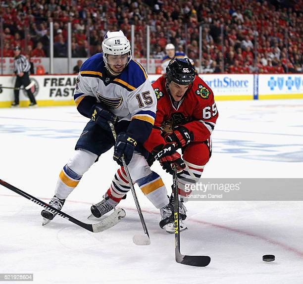 Andrew Shaw of the Chicago Blackhawks and Robby Fabbri of the St Louis Blues battle for the puck in Game Three of the Western Conference...