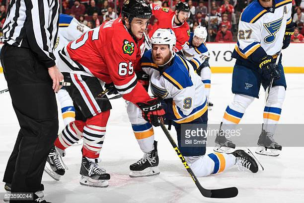 Andrew Shaw of the Chicago Blackhawks and Steve Ott of the St Louis Blues face off in the first period of Game Six of the Western Conference First...