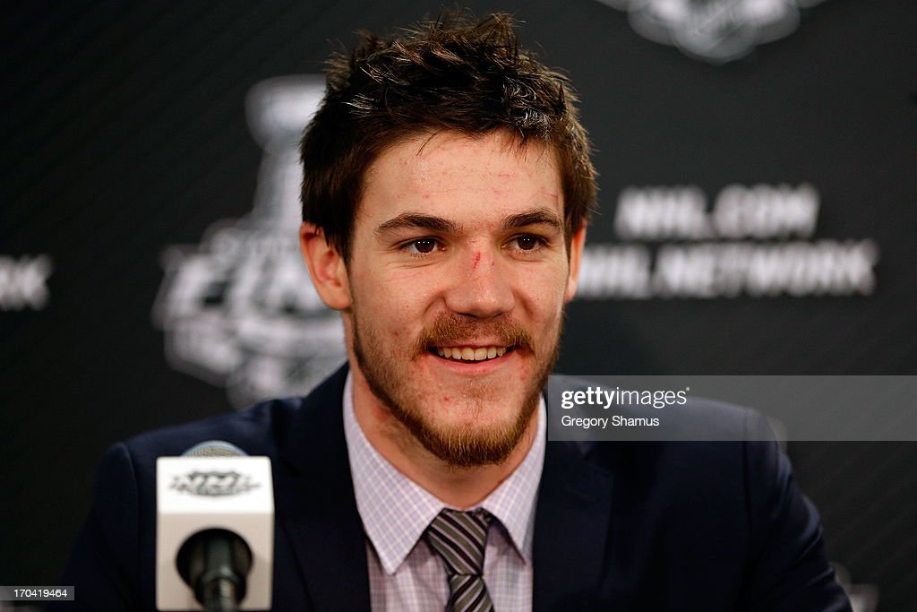 Andrew Shaw #65 of the Chicago Blackhawks answers questions from the media at a post game press conference after he scored the game-winning goal in the third overtime to give them a 4-3 win against the Boston Bruins in Game One of the 2013 NHL Stanley Cup Final at United Center on June 12, 2013 in Chicago, Illinois.