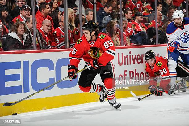 Andrew Shaw of the Chicago Blackhawks approaches the puck ahead of Marko Dano and Andrej Sekera of the Edmonton Oilers in the second period of the...