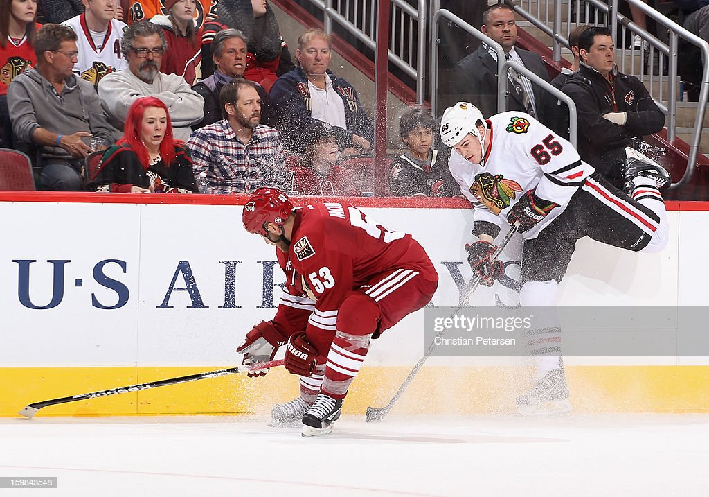 Andrew Shaw #65 of the Chicago Blackhawks avoids a check from Derek Morris #53 of the Phoenix Coyotes during the NHL game at Jobing.com Arena on January 20, 2013 in Glendale, Arizona. The Blackhawks defeated the Coyotes 6-4. (Photo by Christian Petersen/Getty Images