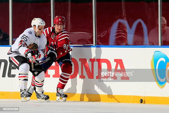 Andrew Shaw of the Chicago Blackhawks battles for the puck with Marcus Johansson of the Washington Capitals during the first period of the 2015 NHL...