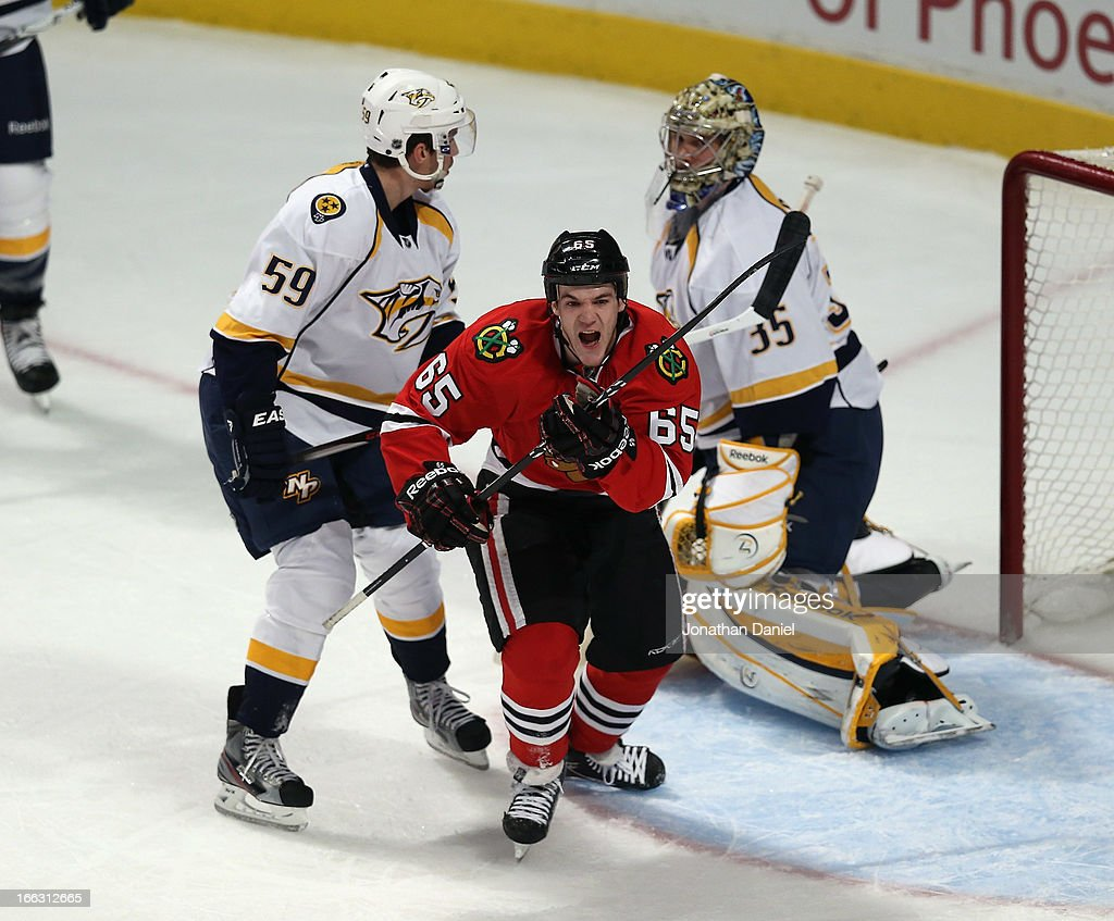 Andrew Shaw #65 of the Chicago Blackhawks celebrates a goal in front of <a gi-track='captionPersonalityLinkClicked' href=/galleries/search?phrase=Roman+Josi&family=editorial&specificpeople=4247871 ng-click='$event.stopPropagation()'>Roman Josi</a> #59 and <a gi-track='captionPersonalityLinkClicked' href=/galleries/search?phrase=Pekka+Rinne&family=editorial&specificpeople=2118342 ng-click='$event.stopPropagation()'>Pekka Rinne</a> #35 of the Nashville Predators at the United Center on April 7, 2013 in Chicago, Illinois. The Blackhawks defeated the Predators 5-3.