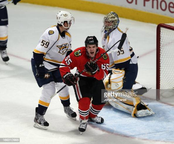 Andrew Shaw of the Chicago Blackhawks celebrates a goal in front of Roman Josi and Pekka Rinne of the Nashville Predators at the United Center on...