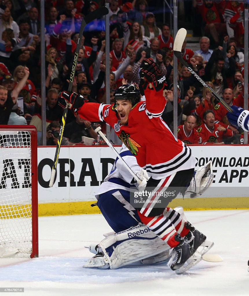 Andrew Shaw of the Chicago Blackhawks celebrates a Hawks goal against the Tampa Bay Lightning during Game Three of the 2015 NHL Stanley Cup Final at...