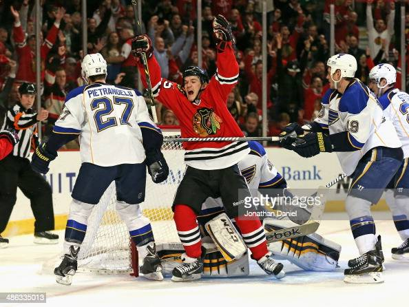 Andrew Shaw of the Chicago Blackhawks celebrates a second period goal between Alex Pietrangelo and Jay Bouwmeester of the St Louis Blues in Game Four...