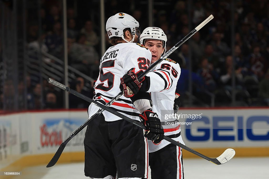 Andrew Shaw #65 of the Chicago Blackhawks celebrates his first period goal with <a gi-track='captionPersonalityLinkClicked' href=/galleries/search?phrase=Viktor+Stalberg&family=editorial&specificpeople=5802237 ng-click='$event.stopPropagation()'>Viktor Stalberg</a> #25 of the Chicago Blackhawks as they take a 2-0 lead over the Colorado Avalanche at the Pepsi Center on March 18, 2013 in Denver, Colorado.