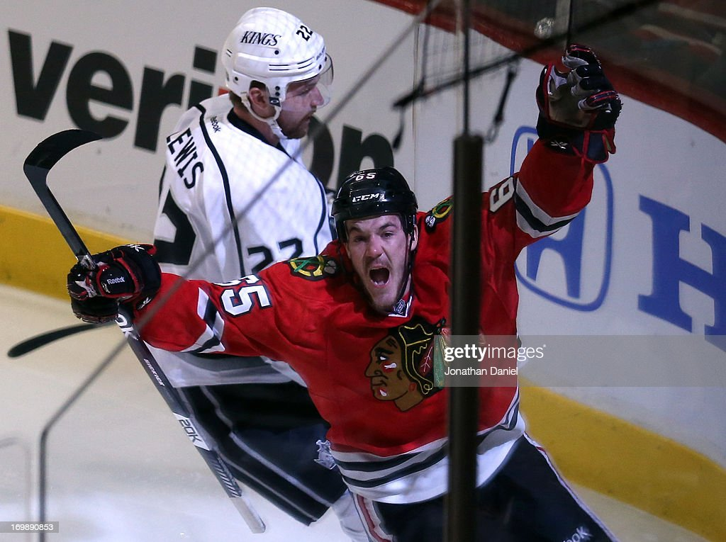 Andrew Shaw #65 of the Chicago Blackhawks celebrates his goal in the first period of Game Two of the Western Conference Final as <a gi-track='captionPersonalityLinkClicked' href=/galleries/search?phrase=Trevor+Lewis&family=editorial&specificpeople=543187 ng-click='$event.stopPropagation()'>Trevor Lewis</a> #22 of the Los Angeles Kings looks on during the 2013 NHL Stanley Cup Playoffs at United Center on June 2, 2013 in Chicago, Illinois. The Blackhawks defeated the Kings 4-2.