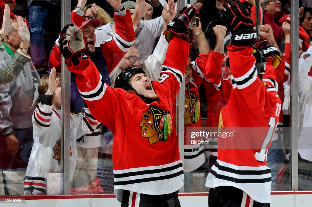 Andrew Shaw #65 of the Chicago Blackhawks celebrates with teammate <a gi-track='captionPersonalityLinkClicked' href=/galleries/search?phrase=Jonathan+Toews&family=editorial&specificpeople=537799 ng-click='$event.stopPropagation()'>Jonathan Toews</a> #19 after scoring against the Detroit Red Wings in the second period in Game Five of the Western Conference Semifinals during the 2013 Stanley Cup Playoffs at the United Center on May 25, 2013 in Chicago, Illinois.