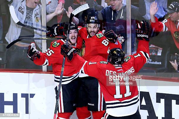 Andrew Shaw of the Chicago Blackhawks celebrates with teammates after scoring a third period goal against the Anaheim Ducks in Game Six of the...