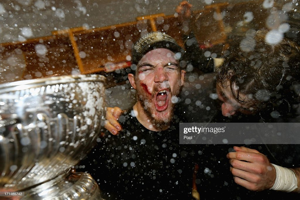 Andrew Shaw #65 of the Chicago Blackhawks celebrates with the Stanley Cup in the locker room after defeating the Boston Bruins in Game Six of the 2013 NHL Stanley Cup Final at TD Garden on June 24, 2013 in Boston, Massachusetts. The Chicago Blackhawks defeated the Boston Bruins 3-2.