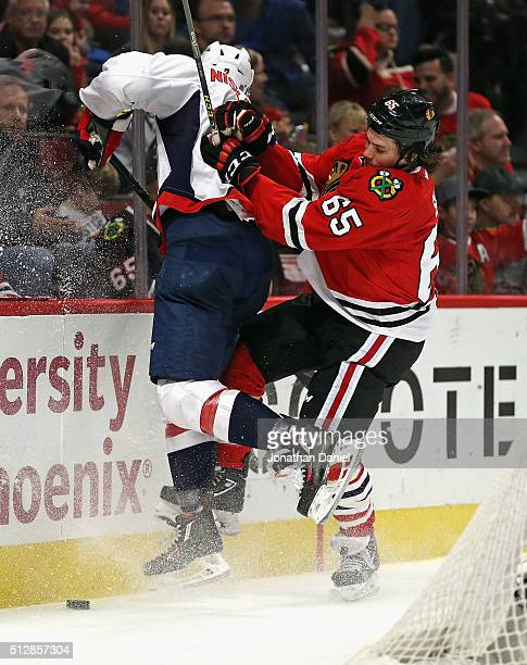 Andrew Shaw of the Chicago Blackhawks check Matt Niskanen of the Washington Capitals into the boards at the United Center on February 28 2016 in...