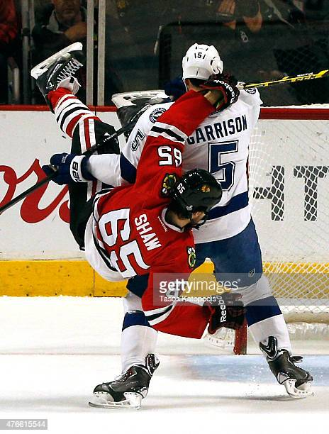Andrew Shaw of the Chicago Blackhawks collides with Jason Garrison of the Tampa Bay Lightning in the first period during Game Four of the 2015 NHL...