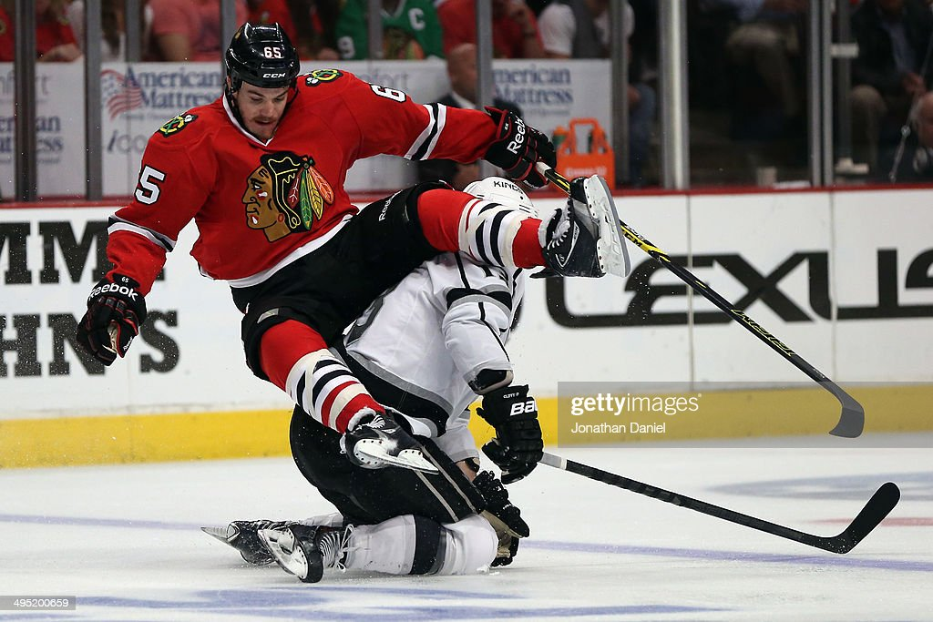 Andrew Shaw #65 of the Chicago Blackhawks collides with <a gi-track='captionPersonalityLinkClicked' href=/galleries/search?phrase=Kyle+Clifford&family=editorial&specificpeople=4640225 ng-click='$event.stopPropagation()'>Kyle Clifford</a> #13 of the Los Angeles Kings during Game Seven of the Western Conference Final in the 2014 Stanley Cup Playoffs at United Center on June 1, 2014 in Chicago, Illinois.