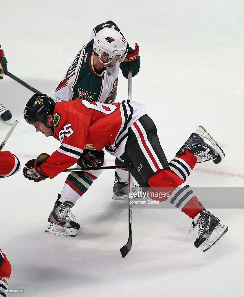 Andrew Shaw #65 of the Chicago Blackhawks collides with Torrey Mitchell #17 of the Minnesota Wild in Game One of the Western Conference Quarterfinals during the 2013 NHL Stanley Cup Playoffs at the United Center on April 30, 2013 in Chicago, Illinois.