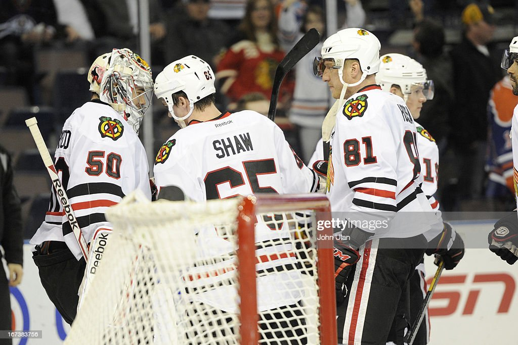 Andrew Shaw #65 of the Chicago Blackhawks congratulates goalie <a gi-track='captionPersonalityLinkClicked' href=/galleries/search?phrase=Corey+Crawford&family=editorial&specificpeople=818935 ng-click='$event.stopPropagation()'>Corey Crawford</a> on his win over the Edmonton Oilers on April 24, 2013 at Rexall Place in Edmonton, Alberta, Canada.