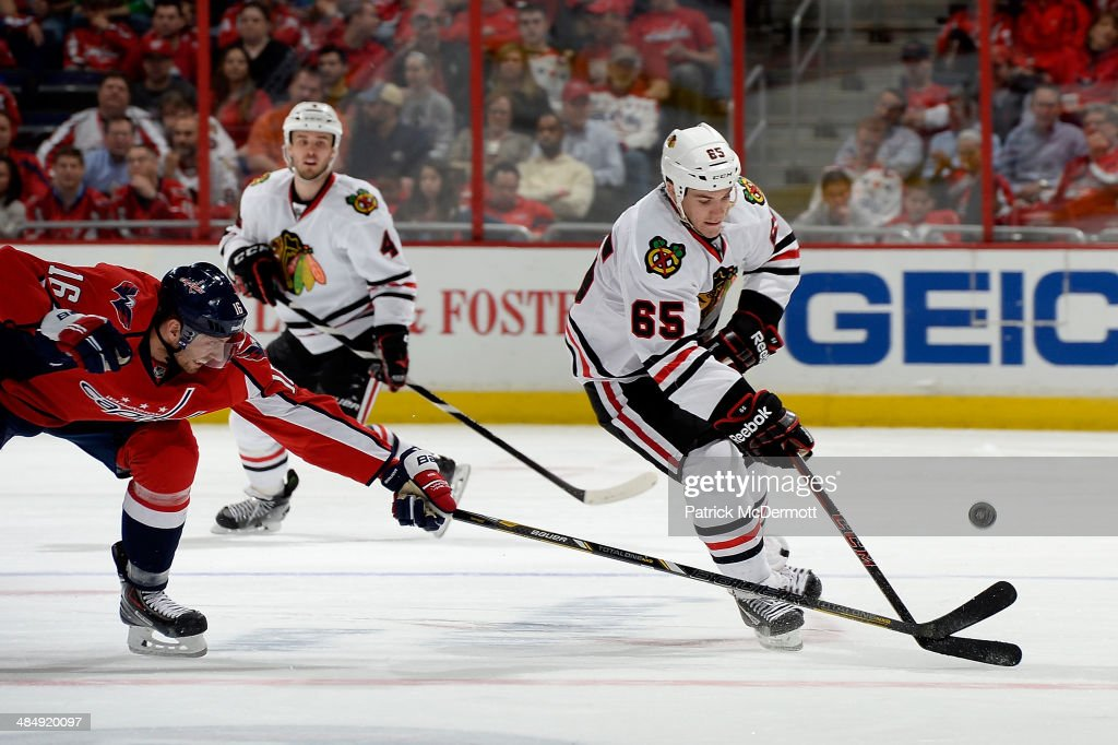 Andrew Shaw #65 of the Chicago Blackhawks controls the puck in the third period during an NHL game against the Washington Capitals at Verizon Center on April 11, 2014 in Washington, DC.