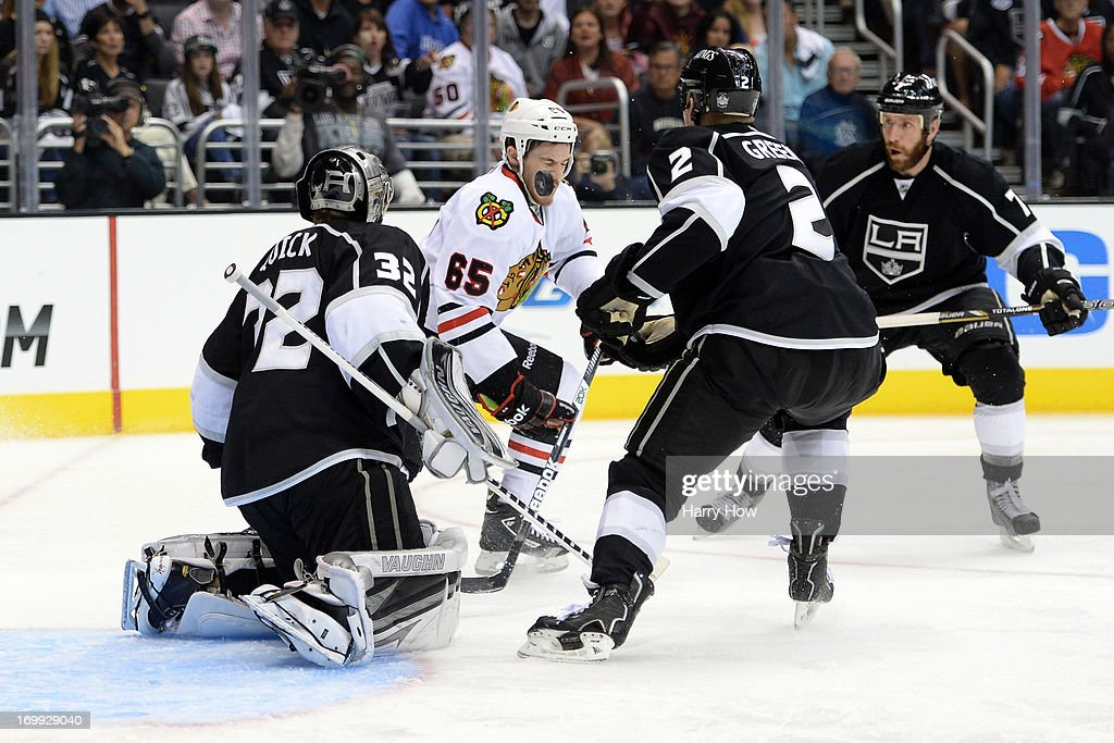 Andrew Shaw #65 of the Chicago Blackhawks deflects the puck in front of goaltender Jonathan Quick #32 of the Los Angeles Kings in the third period of Game Three of the Western Conference Final during the 2013 NHL Stanley Cup Playoffs at Staples Center on June 4, 2013 in Los Angeles, California.