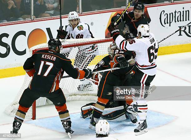 Andrew Shaw of the Chicago Blackhawks hits the puck in the net with his head past goaltender Frederik Andersen of the Anaheim Ducks in the second...