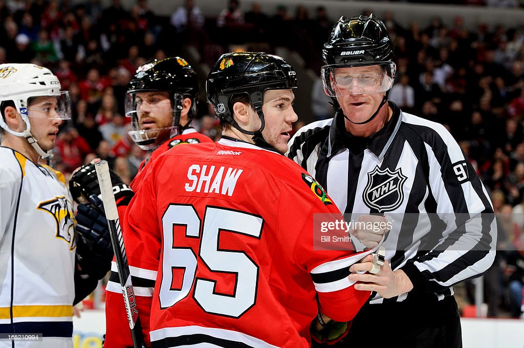 Andrew Shaw #65 of the Chicago Blackhawks is pulled away from a confrontation by linesman Jean Morin #97, as Victor Bartley #64 of the Nashville Predators and <a gi-track='captionPersonalityLinkClicked' href=/galleries/search?phrase=Viktor+Stalberg&family=editorial&specificpeople=5802237 ng-click='$event.stopPropagation()'>Viktor Stalberg</a> #25 of the Chicago Blackhawks stand in the background, during the NHL game on April 01, 2013 at the United Center in Chicago, Illinois.