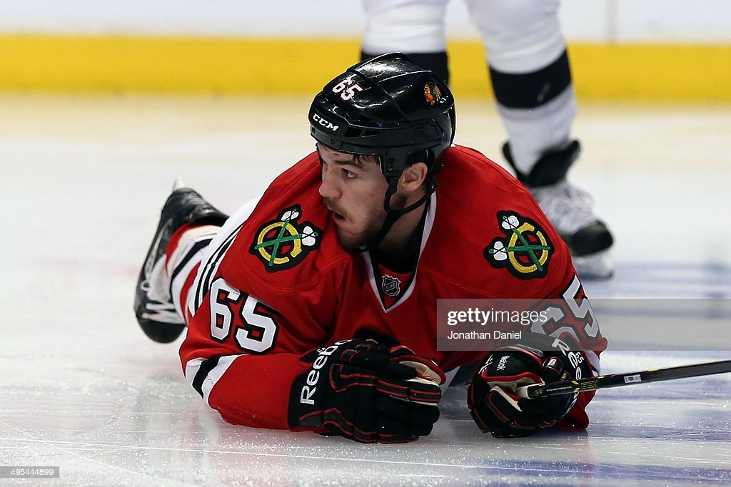 Andrew Shaw #65 of the Chicago Blackhawks lays on the ice against the Los Angeles Kings during Game Seven of the Western Conference Final in the 2014 Stanley Cup Playoffs at United Center on June 1, 2014 in Chicago, Illinois.